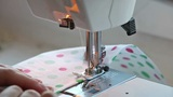 Closeup view of girl sewing on machine Footage