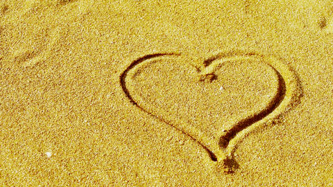 heart on sandy beach,wind blow sand Stock Video Footage