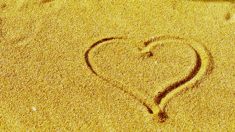 heart on sandy beach,wind blow sand Stock Video Footage