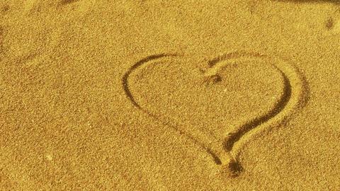 heart on golden sandy beach,wind blow sand Stock Video Footage