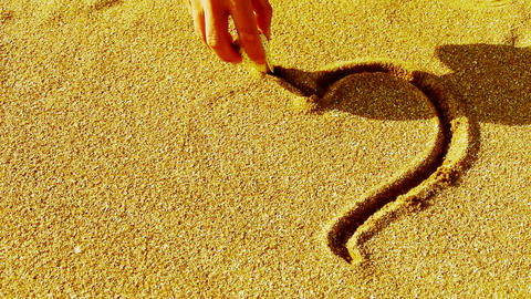a human hand use conch drawing heart sign on golden sand Stock Video Footage
