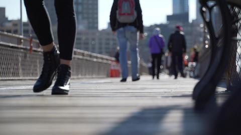 Pedestrians walking on a bridge Footage