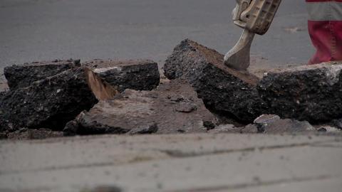Pneumatic hammer crushes asphalt Footage