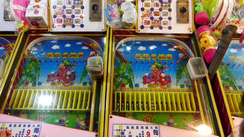 Two old pinball gaming machines, people play, launch steel balls. with sound Footage