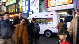 Ambulance car rush through people crowd, nightlife and emergency Footage