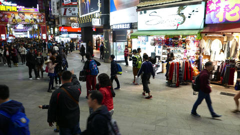 Ximending alley panorama, night life at famous pedestrian zone, crowded street Footage
