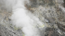 Dry fumarole close up, white toxic fumes from natural dip in earth crust Footage