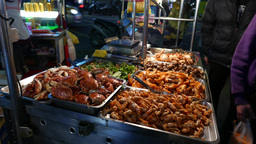 Cooked crabs and shrimps on tray, night market stall Footage