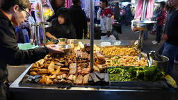 Table full of chinese snacks, market booth, busy street Footage