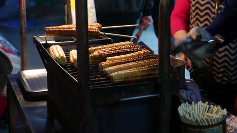 Grilling corn cobs on grate, close up view to roasted cob Footage