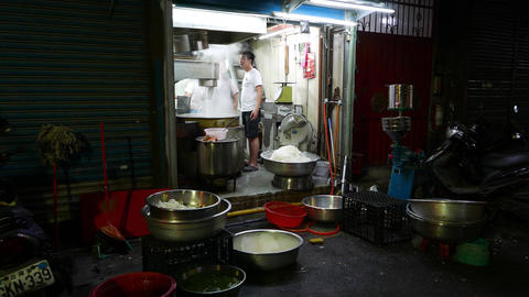 Back Door Of Small Glass Noodles Factory, From Night Street stock footage