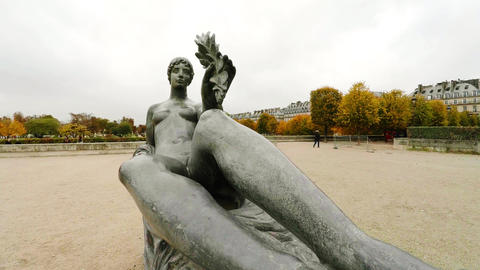The sculpture of a naked girl in Paris. 4K Footage