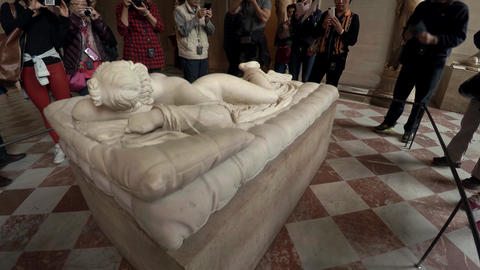 Sculpture of Borghese Hermaphrodite in the Louvre Museum in Paris. France. 4K Live Action