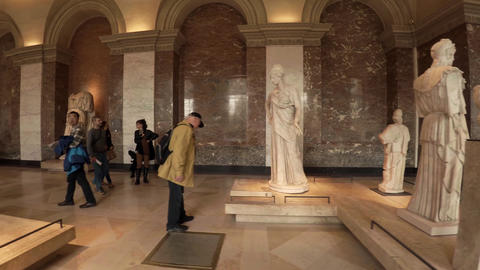 Statues and sculptures in the Louvre museum in Paris. France. 4K Live Action