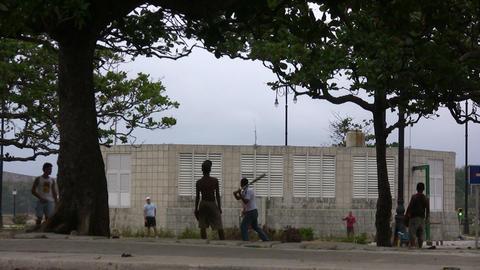 Children playing baseball in park ビデオ