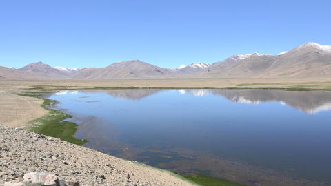 Reflection of Mountain on Water, Pamir Mountains, Tajikistan ビデオ