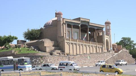Traffic on road, Khwaja Khidr Mosque, Samarkand, Uzbekistan Footage