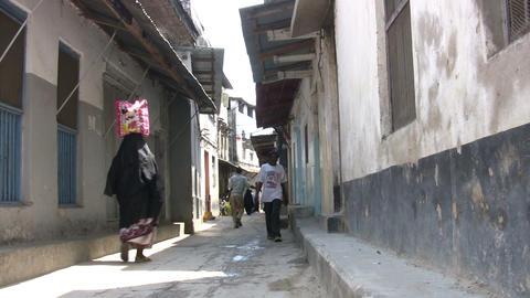People Walking On Narrow Street Footage