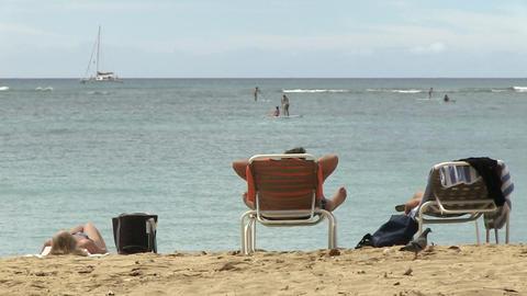 Tourists Relaxing on Beach, Waikiki Footage