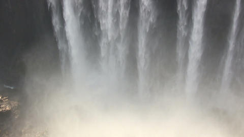 Water Falling From Rocks Into River Footage