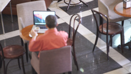 Adult man drinking coffee and working Footage