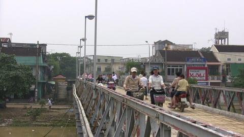 People Riding Vehicle on a Footbridge Footage
