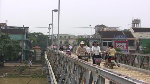 People Riding Vehicle on a Footbridge Footage