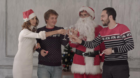 Group of people toasting at a celebration of christmas and clinking their glasse Footage