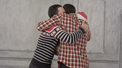 Friends Hug On Christmas With Gifts stock footage
