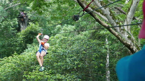European woman doing canopy tour in the jungle Footage