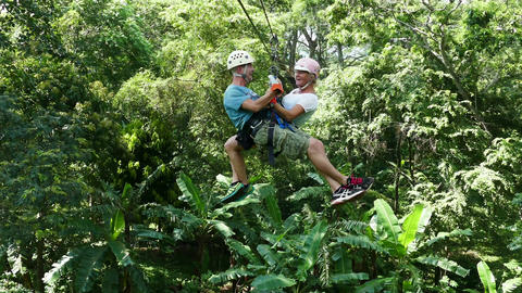 European couple doing canopy tour in the jungle Footage