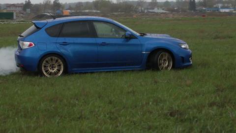 Blue car drift on green grass Footage