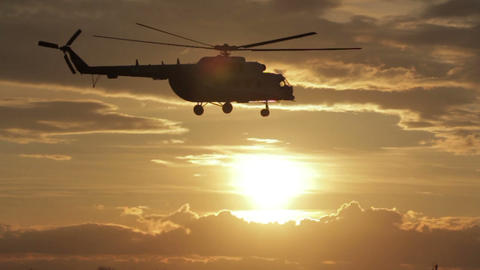 Helicopter Takes Off At Sunset stock footage