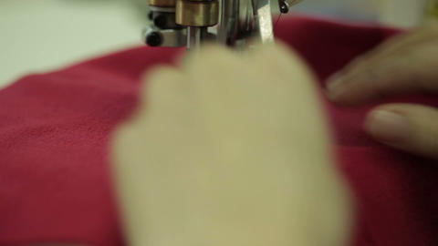 Red сlothe sew on the sewing machine Footage