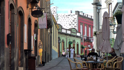 Spain Gran Canary Arucas 012 street cafe between colorful old houses Footage
