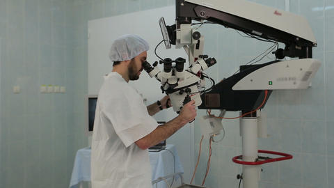 Man using a big microscope system in a medical laboratory Footage
