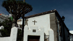 Spain Gran Canary Arucas 017 whitewashed house corner with a crucifix Footage