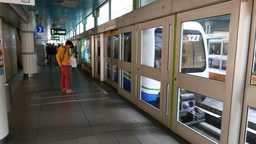 Taipei Rapid Transit train arrival at overground station glass doors and wall Live Action