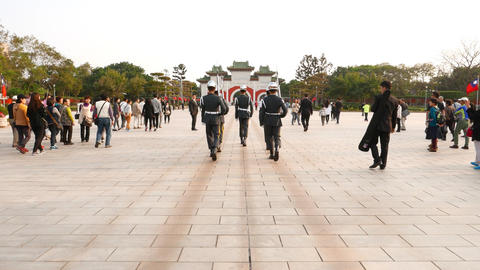 POV walk behind honour guards march across large square Live Action