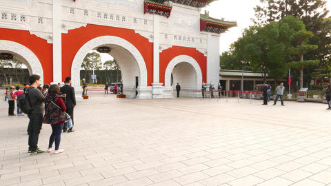 Martyr Shrine gate, paifang establishing shot. Guards march from quarters Footage
