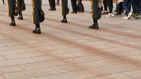 Soldiers boots close view, march on tiled pavement. Slow and coordinated steps Footage