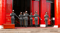 Honour guards salute after commander order, stand against Shrine entrance Footage