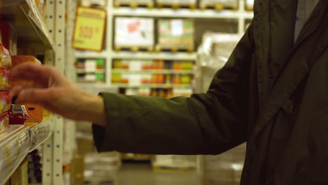 Man choose products in the hypermarket Footage