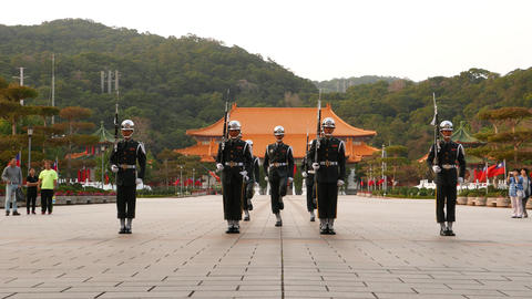 Guard troop march towards camera, sentinel change ceremony Footage