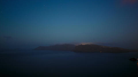 Greek Santorini Caldera Timelapse from Night to Dawn Showing Stars and Boats Footage