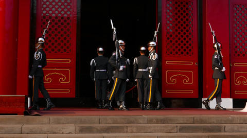Officers turn, flip rifle, salute during ceremonial guard change ceremony Live Action