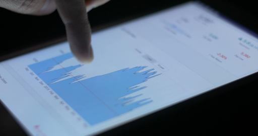 Stock market trading finance graph and chart on ipad pad Footage
