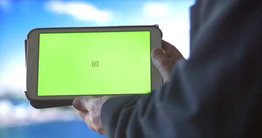 Ipad Tablet PC with Green Screen city background Footage