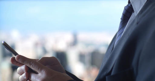 Business man texting using mobile cell phone technology city background Footage