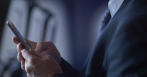 Business Person Traveling On Air Plane Checking Mobile Cell Smartphone stock footage